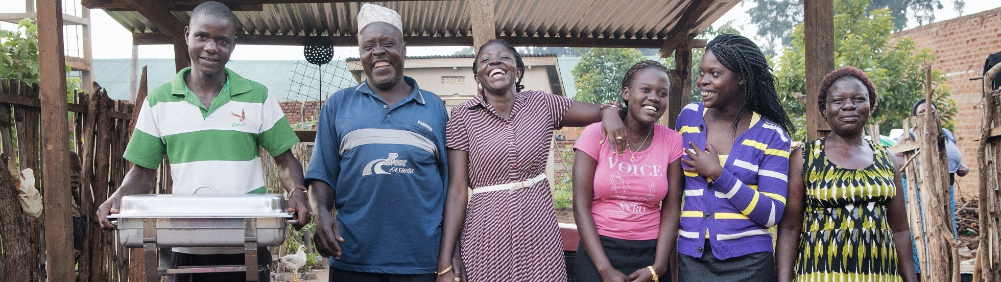 Leticia Nabirye, 30 (in dress with stripes), with her restaurant's staff in the kitchen at the back of the restaurant in Kibuku Town Council, Kibuku District, Uganda on August 6 2013.